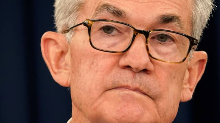 Dow futures slightly higher after Fed chief signals a rate cut