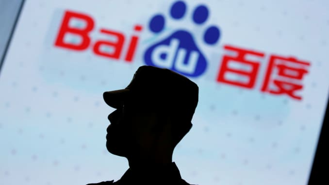 A security personnel stands guard at the opening session of Baidu's annual AI developers conference Baidu Create 2019 in Beijing, China, July 3, 2019.