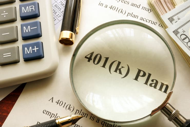 GP: Document with title 401k plan on a table.