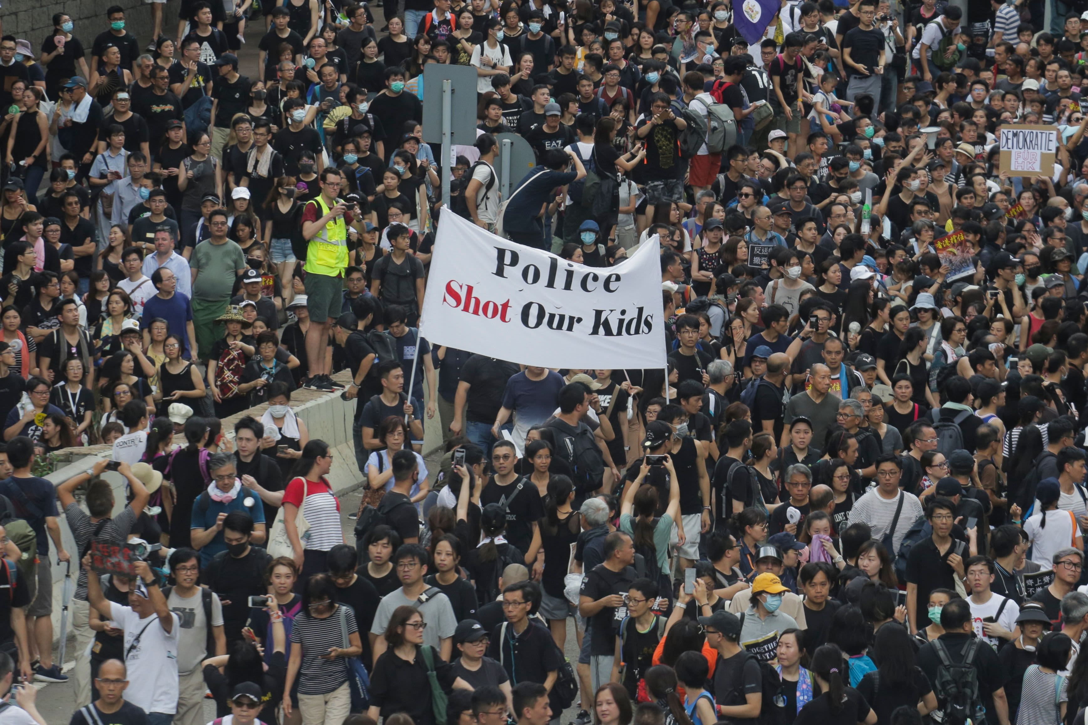 Hong Kong protesters march again, this time taking their message to mainland Chinese tourists