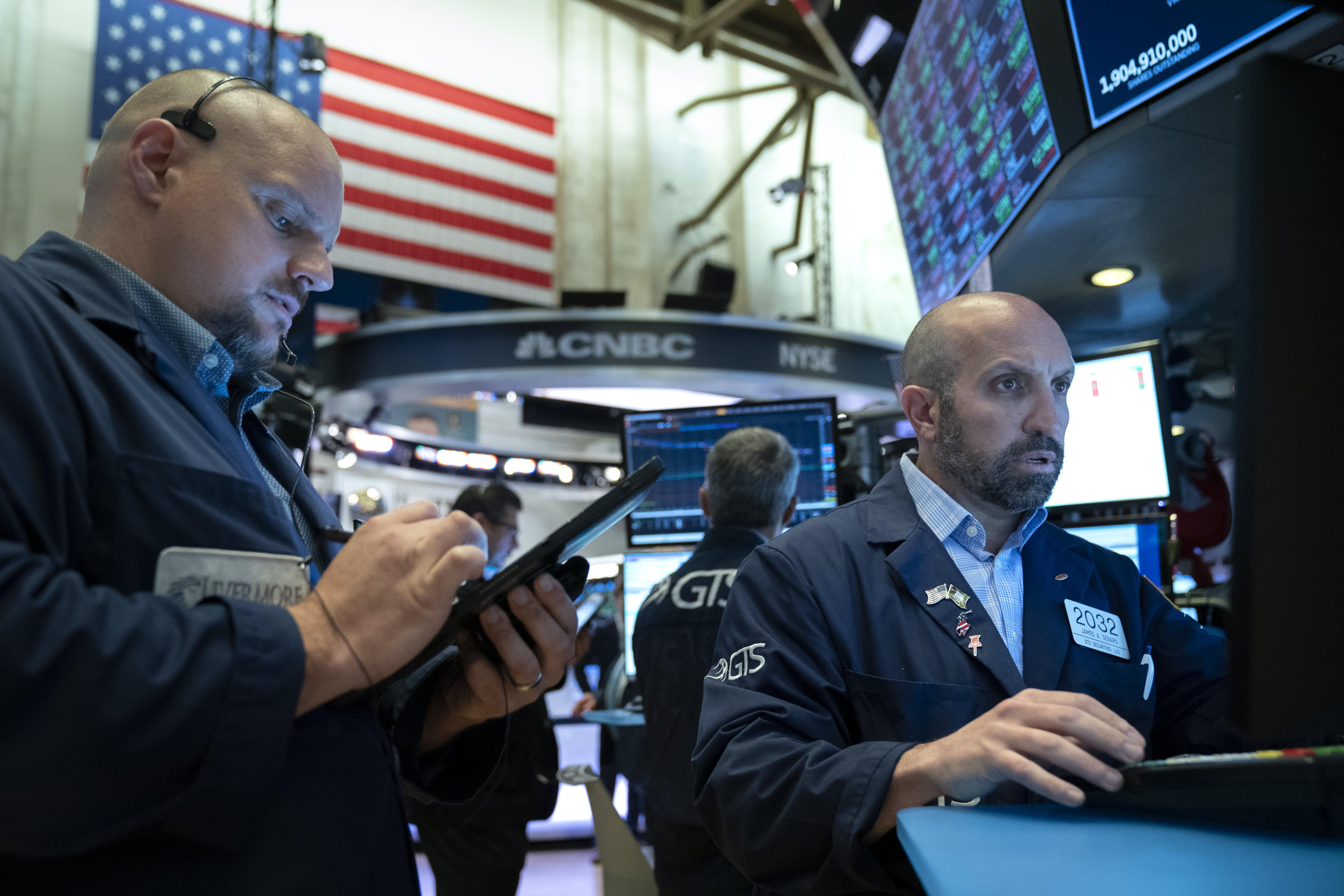 Stocks making the biggest moves premarket: Deutsche Bank, Verizon, Apple & more