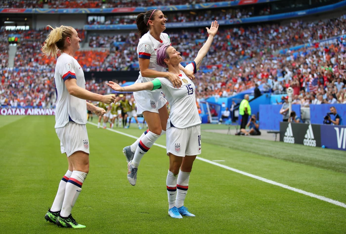 celebrates with teammates alex morgan and samantha mewis after scoring her team s first goal during the 2019 fifa women s world cup france final match