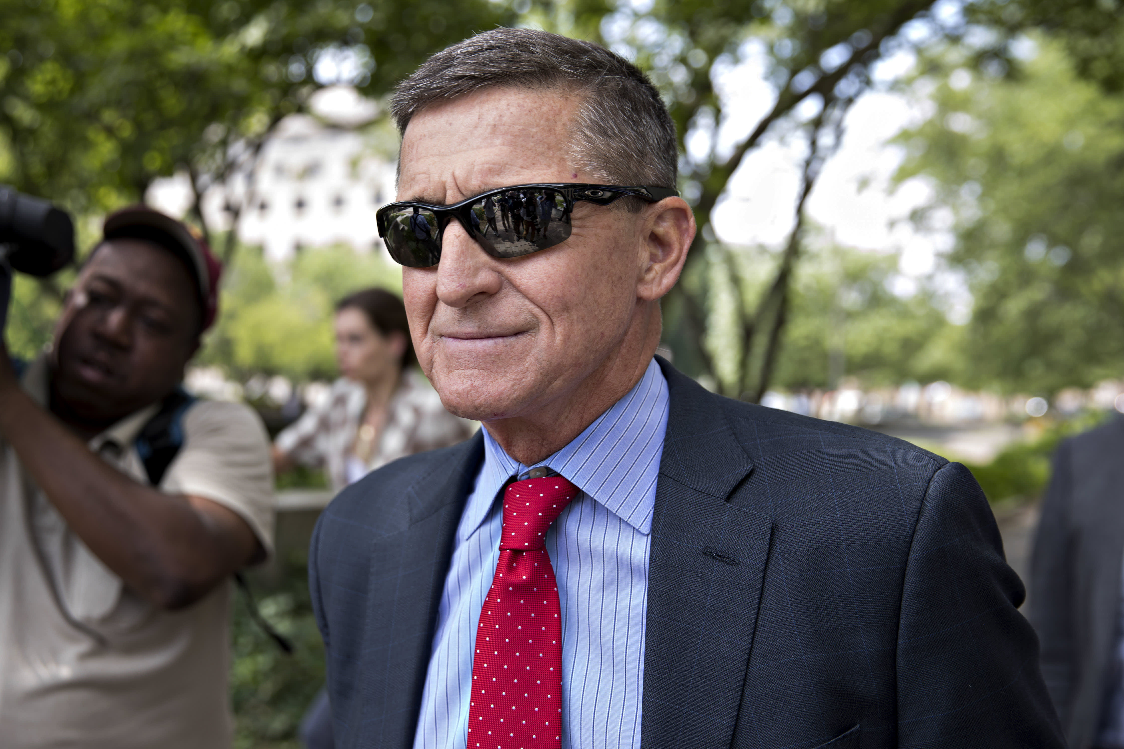 Attorney General Barr orders review of criminal case against former Trump aide Michael Flynn