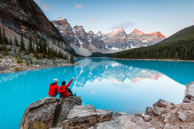 GP: Couple looking at Moraine lake, Banff, Canada