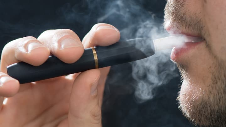 IQOS boosts Philip Morris International's quarterly profit, revenue. Stock jumps