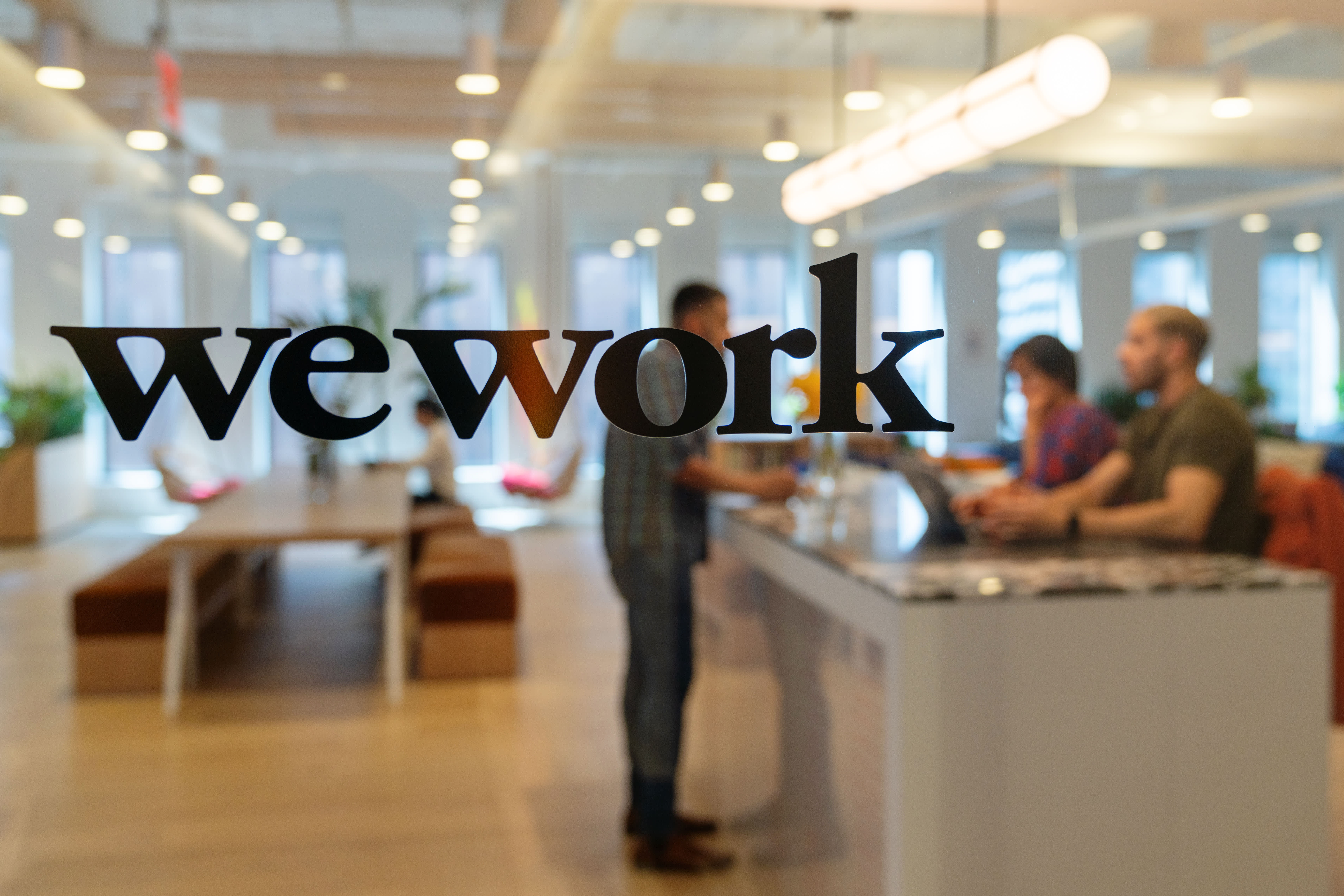 WeWork is dramatically slashing its IPO valuation to less than $25 billion because of weak demand
