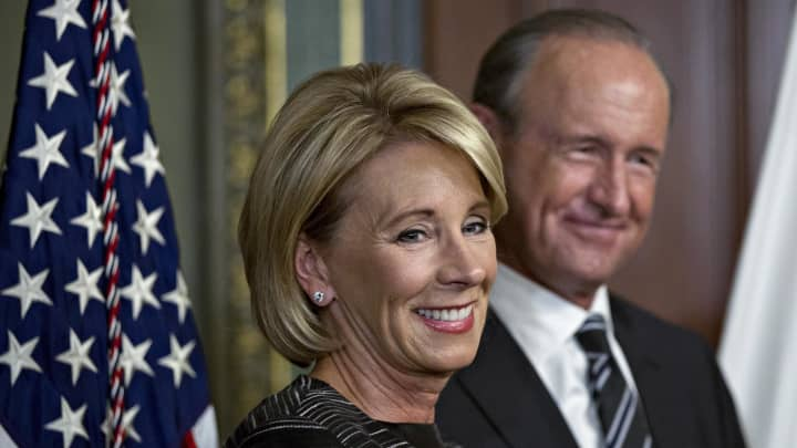 Betsy DeVos and family see profits soar after Trump tax reform bill, deregulation efforts