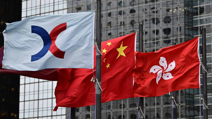From left, the flags of the Hong Kong Stock Exchange, China and Hong Kong are seen flapping in the wind on May 6, 2019.