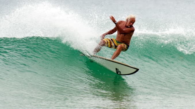 Old man wave surfing