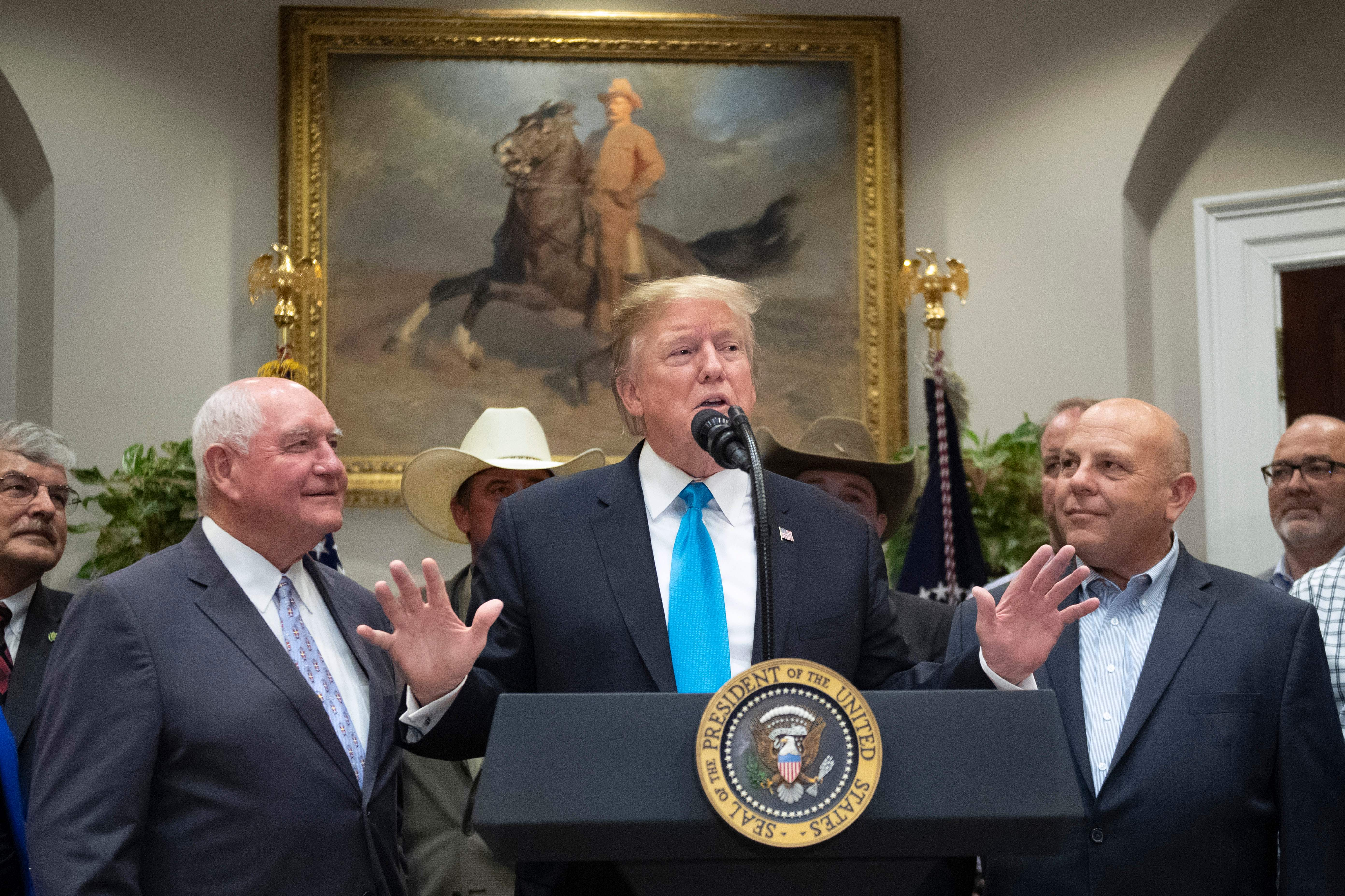 Trump promises more aid for farmers in 2020 as China trade