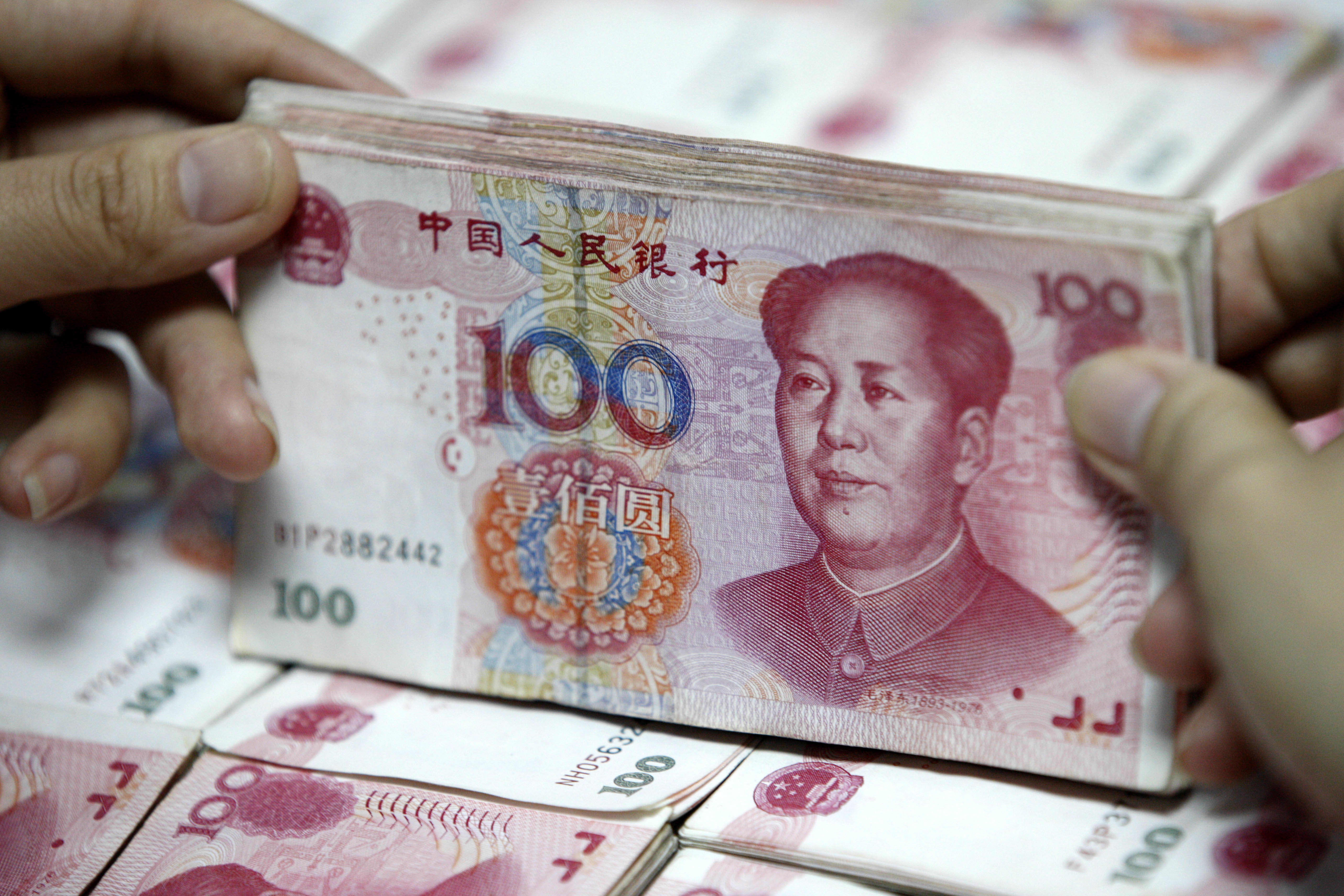 China Yuan Surges Past 7 Per Dollar For The First Time