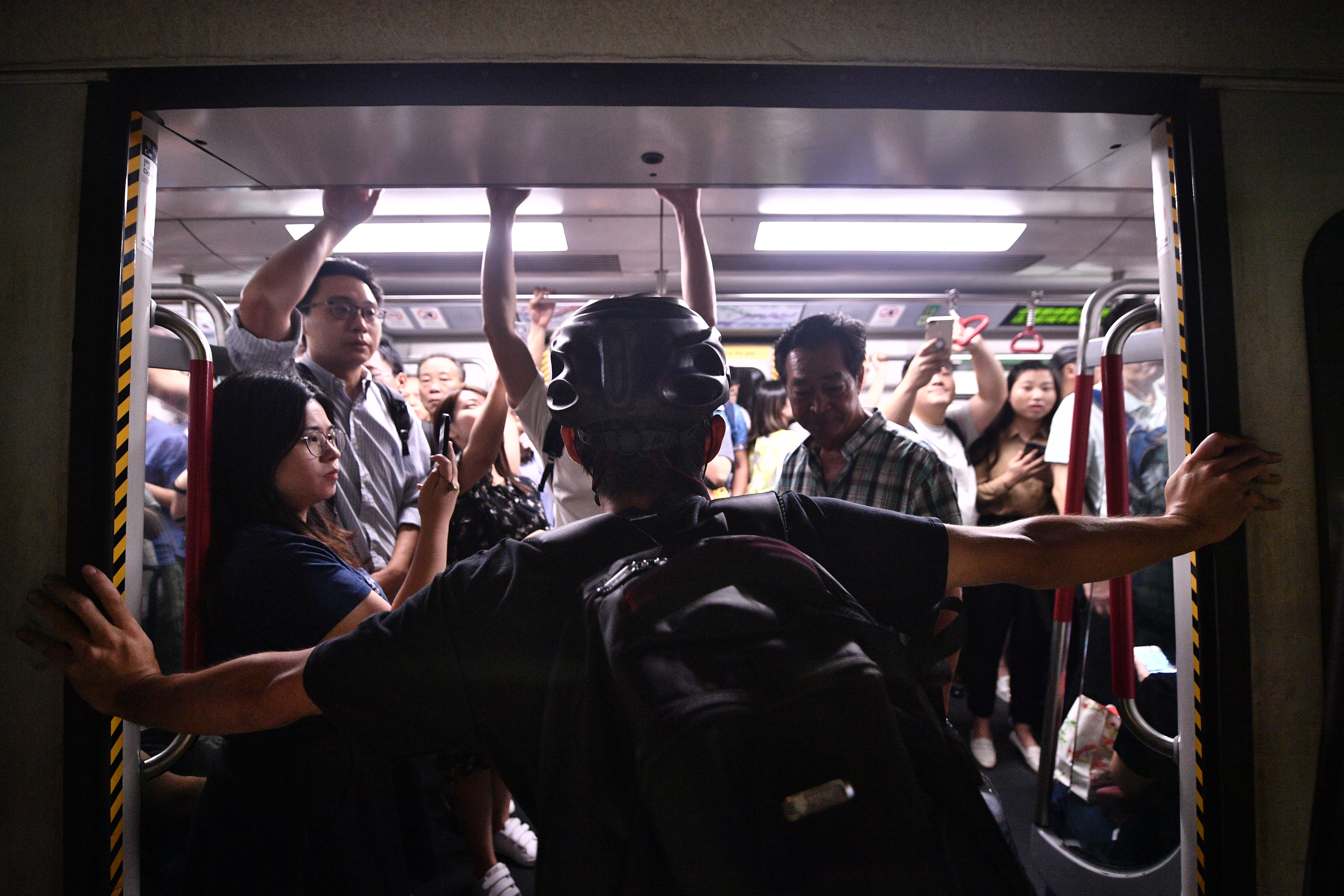 Hong Kong's main public train system struggles to serve commuters amid protests thumbnail