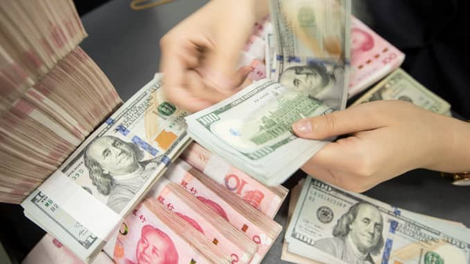 Yuan: People's Bank of China sets RMB midpoint at 7 0326 per dollar