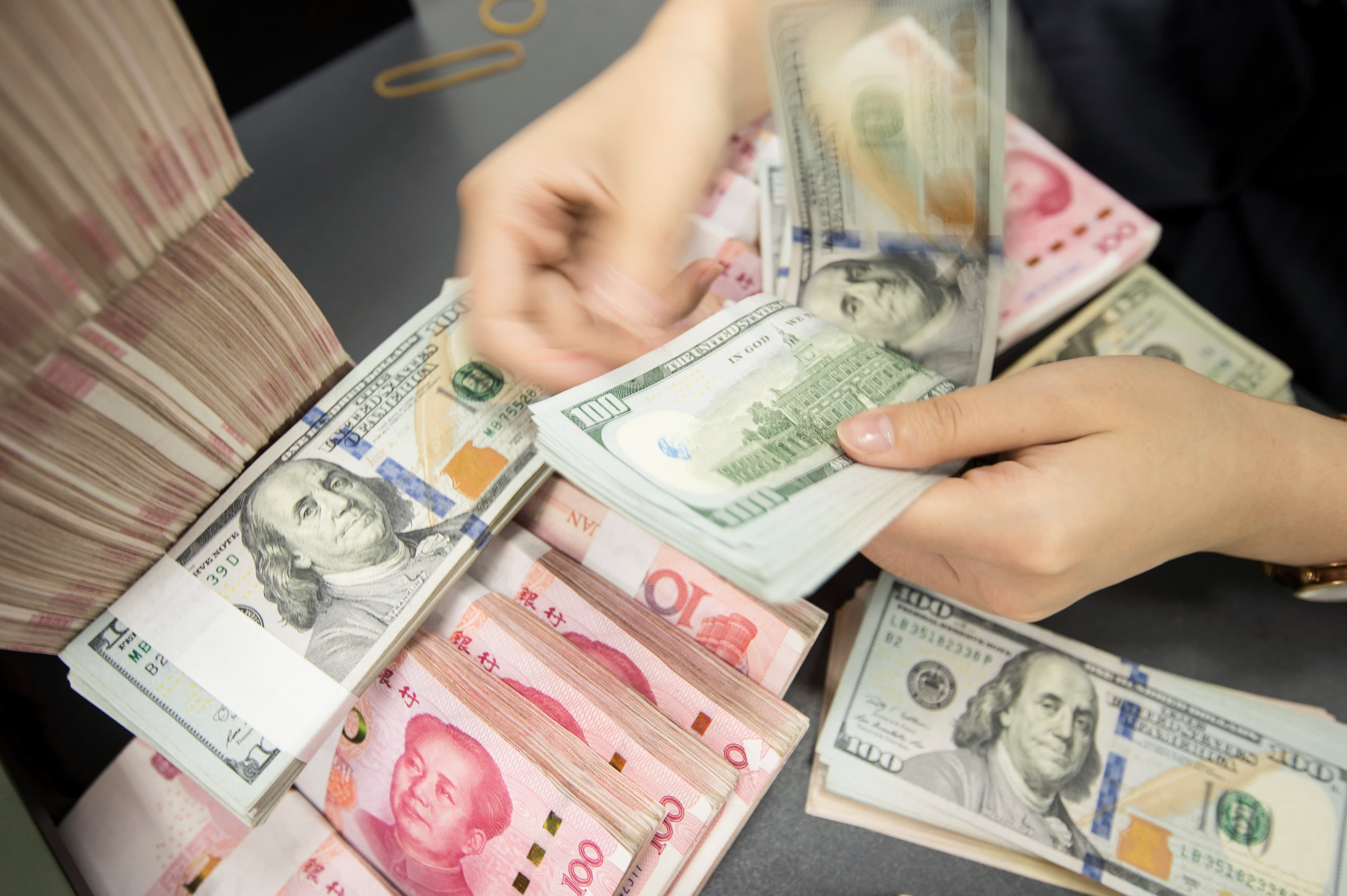 China fixes its daily yuan midpoint at 7.0268 — weaker than expected