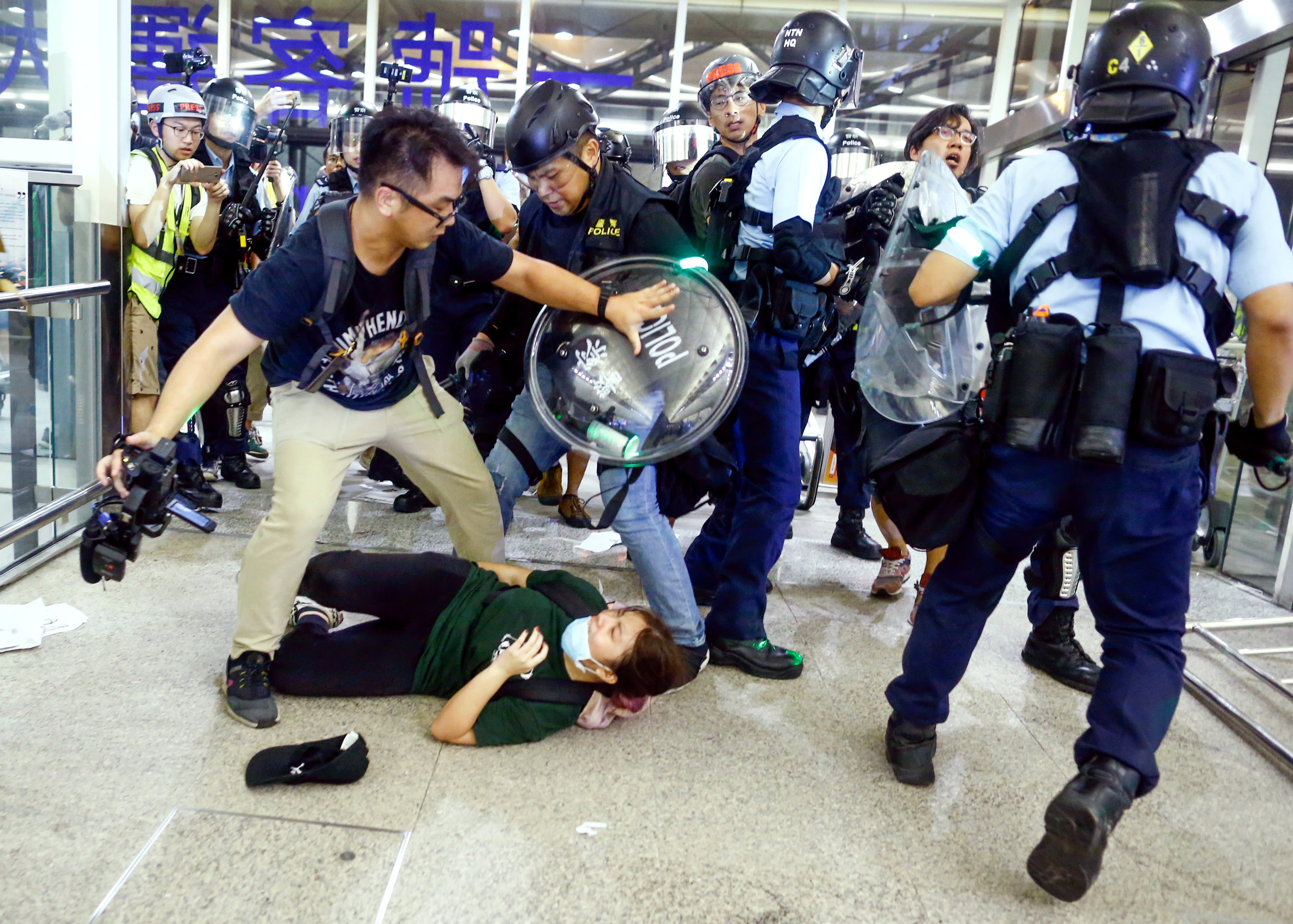 Hong Kong airport returns to calm, after riot police clashed with protesters earlier