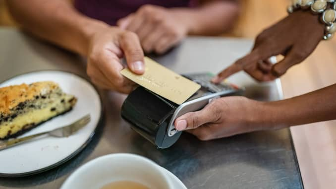Credit Card Contactless Wireless Payment in Coffee Shop