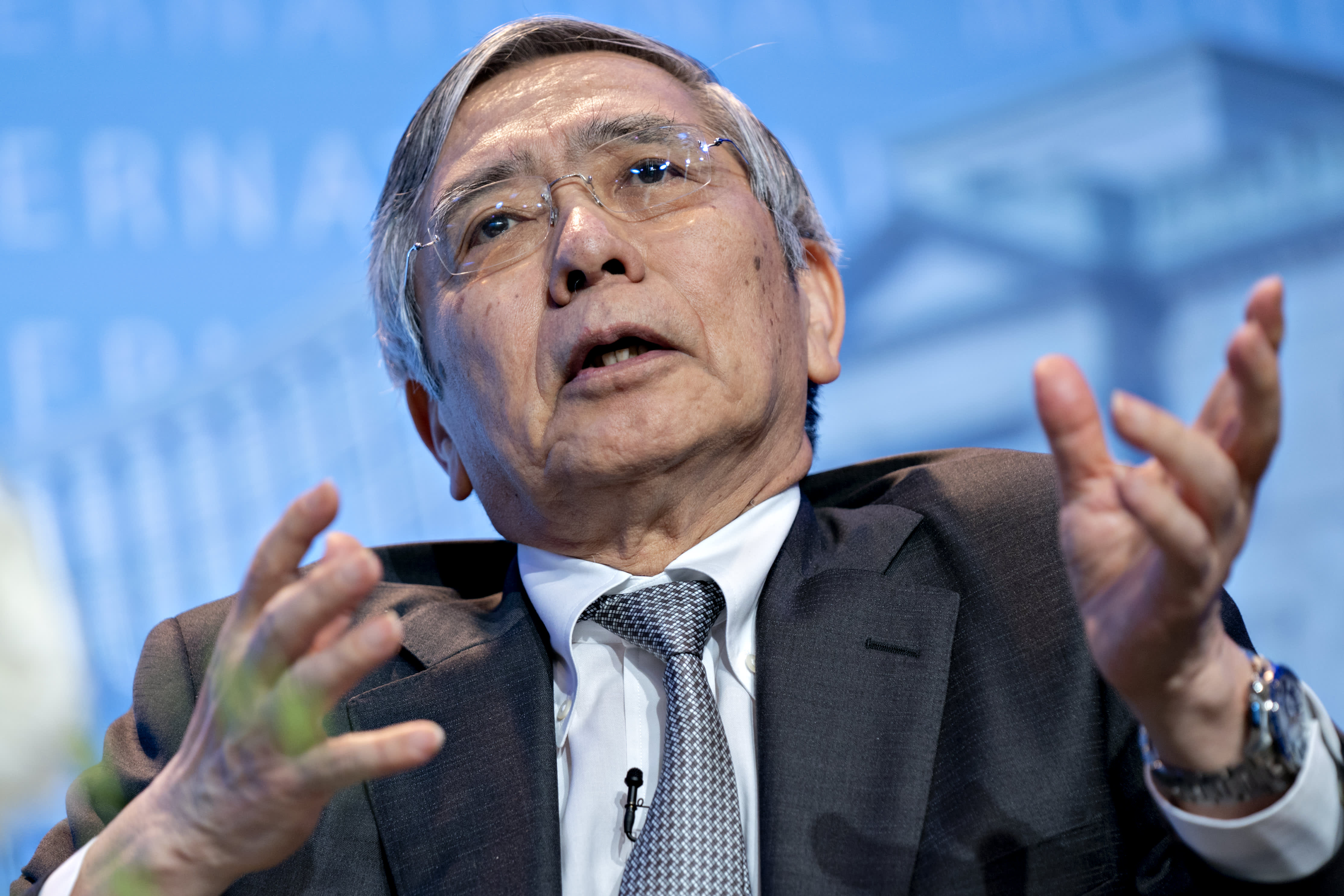 Bank of Japan keeps rates on hold and nudges up growth forecast