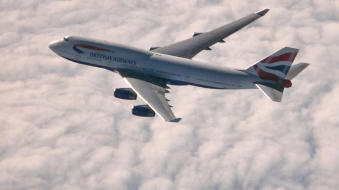 GP: British Airways airoplane Boeing B747-400 in the sky above clouds,