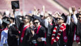 Graduating Stanford University students turn around to thank their parents during the 125th Stanford University commencement ceremony in Stanford, California.