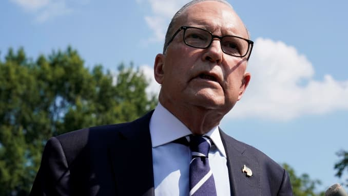 White House chief economic advisor Larry Kudlow speaks with reporters on the driveway outside the West Wing of the White House in Washington, July 26, 2019.