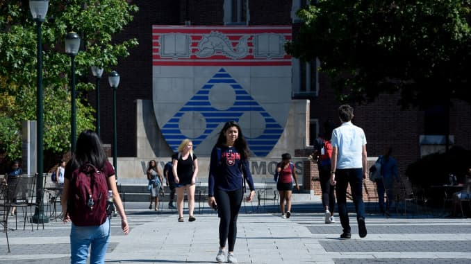 Students walk between classes in the Wynn Commons on the campus of the University of Pennsylvania in Philadelphia, Pennsylvania, U.S.