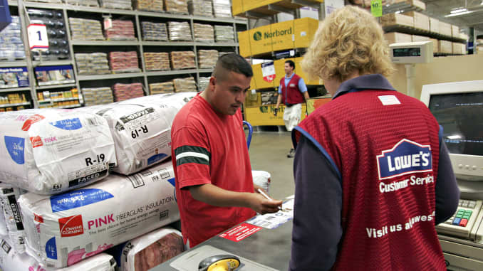A customer pays for his purchases inside a Lowe's store in Cary, North Carolina.