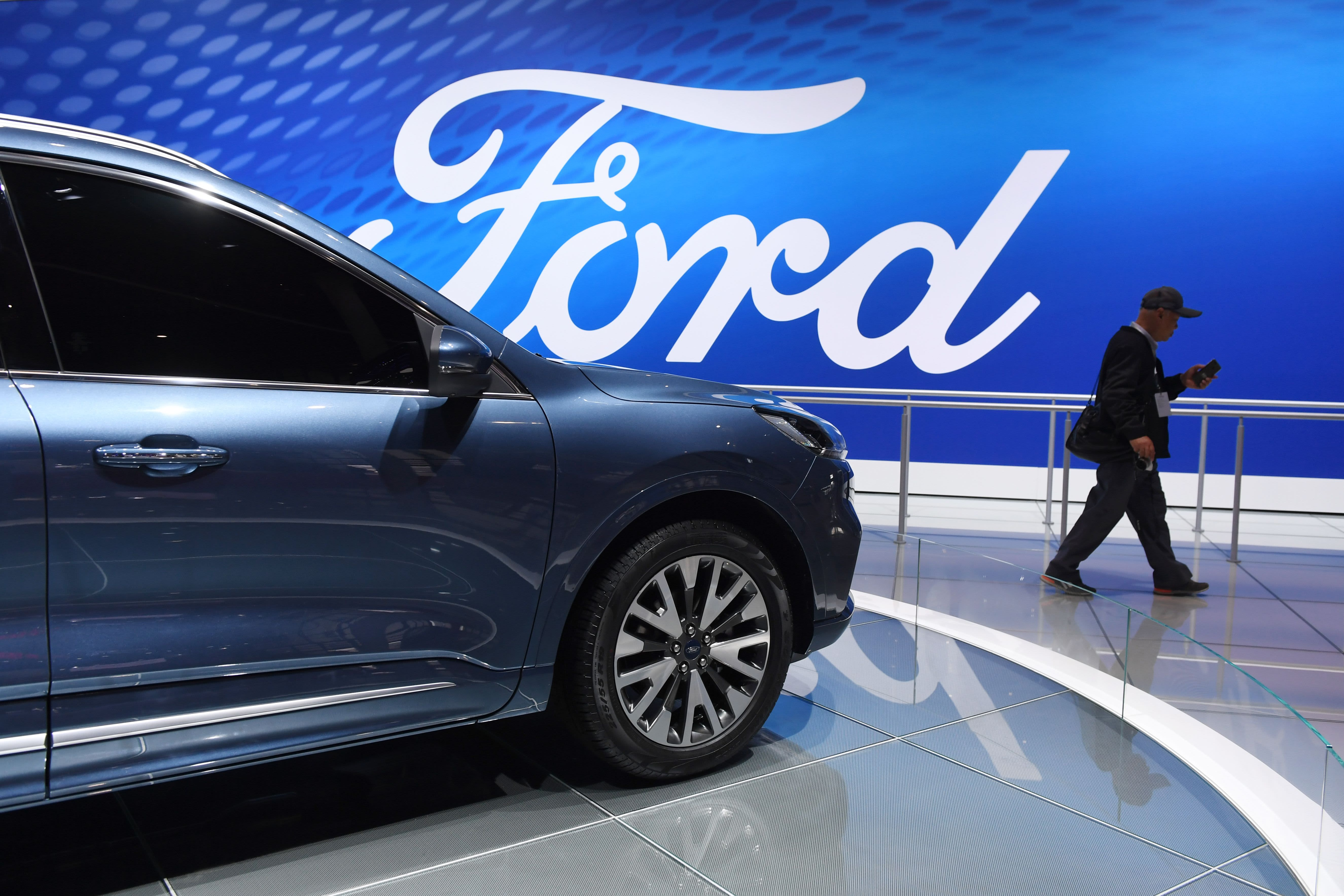 Trump forces automakers to walk a fine line on fuel economy rules as Ford gets hammered