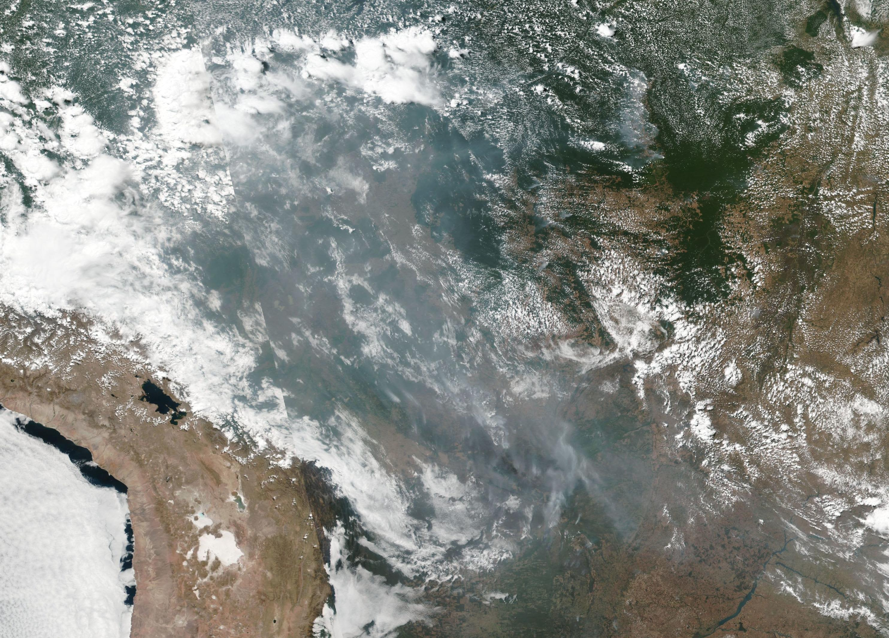 The Amazon rainforest fires in Brazil are visible from space in these NASA pictures