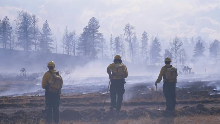Firefighters and fire in Montana caused by global warming