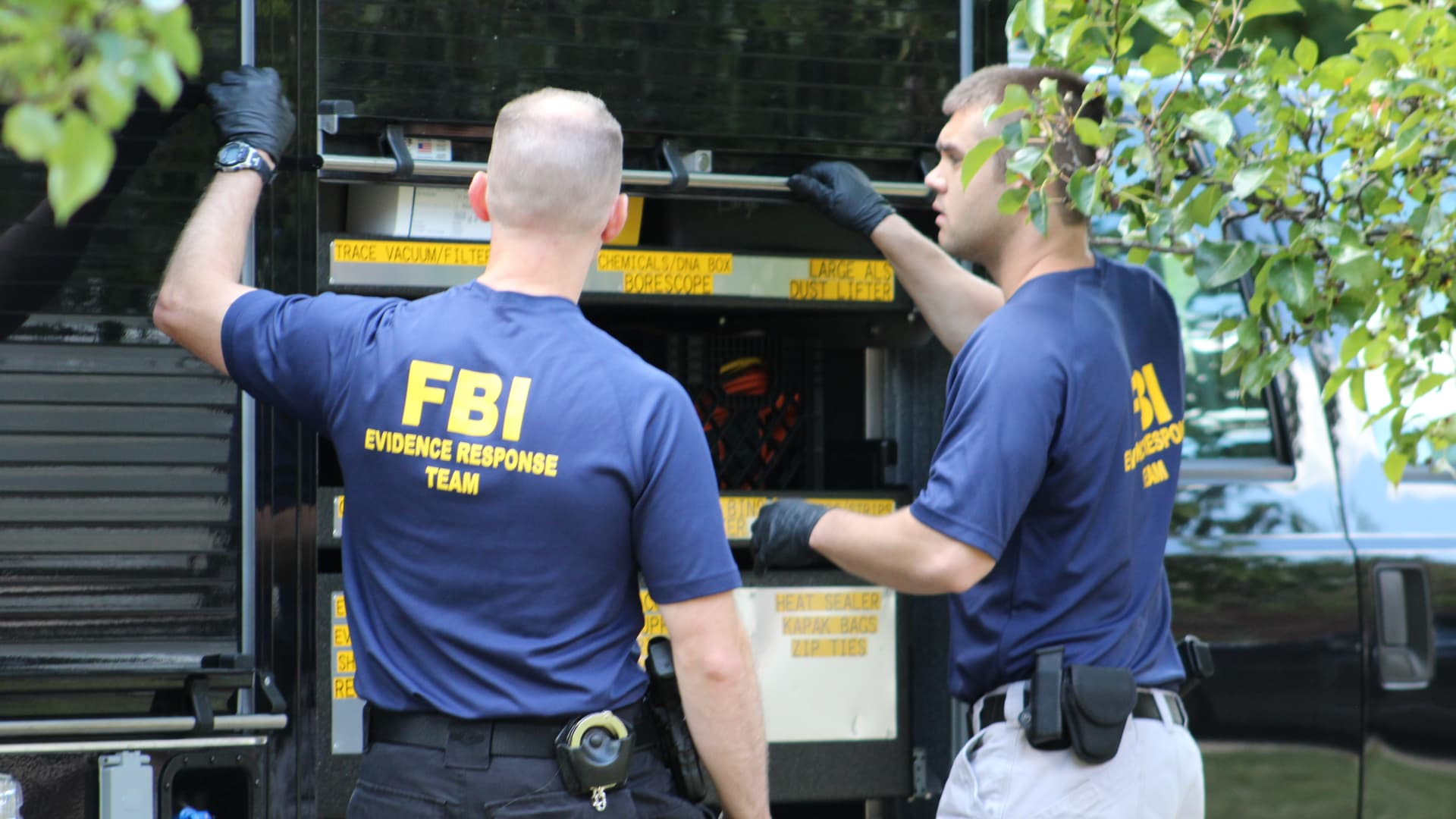 FBI agents finish loading materials into a truck out of the home of United Auto Workers President Gary Jones on Wednesday, Aug. 28, 2019.