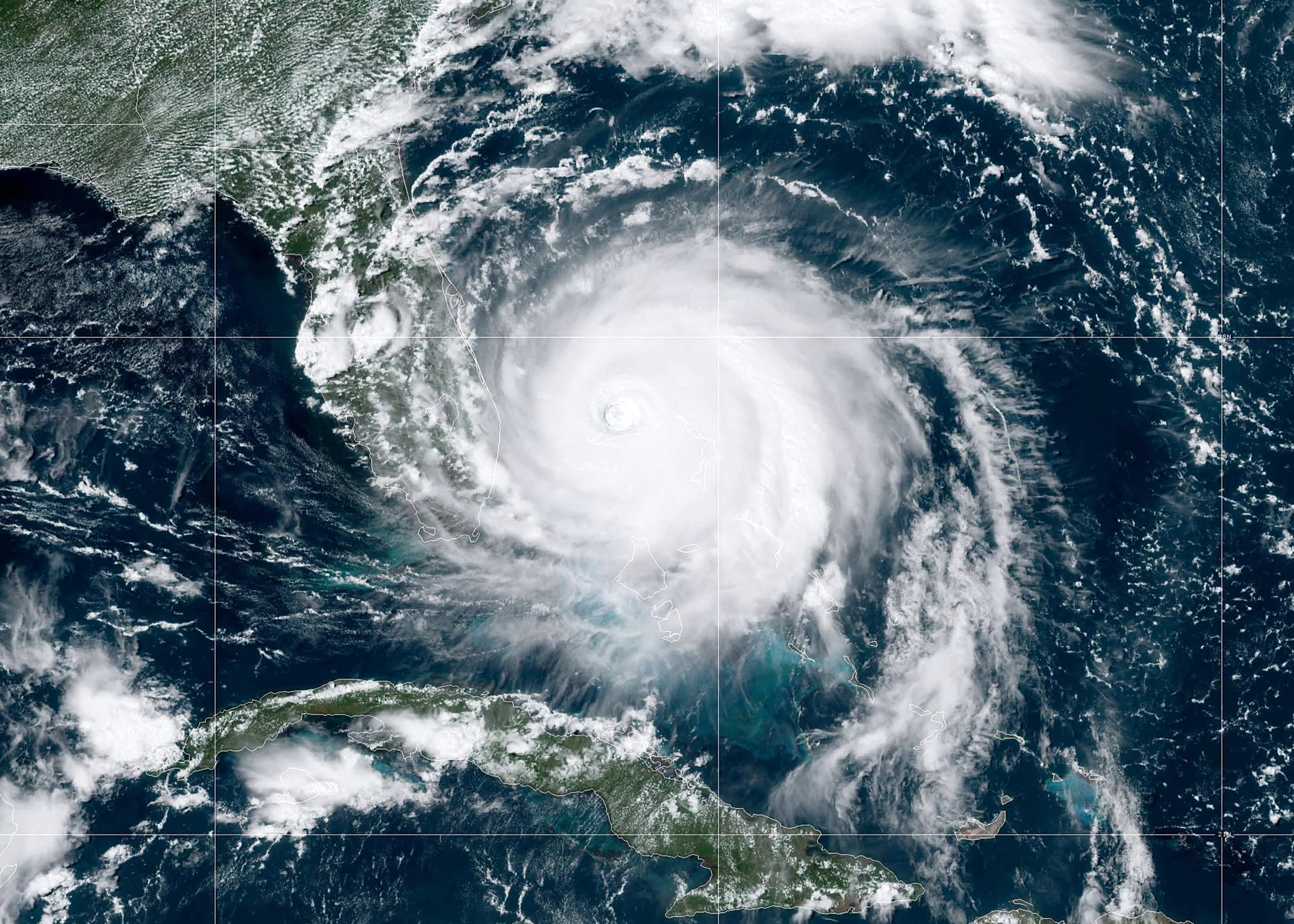 At least 5 dead as 'nearly stationary' Hurricane Dorian pounds the northern Bahamas