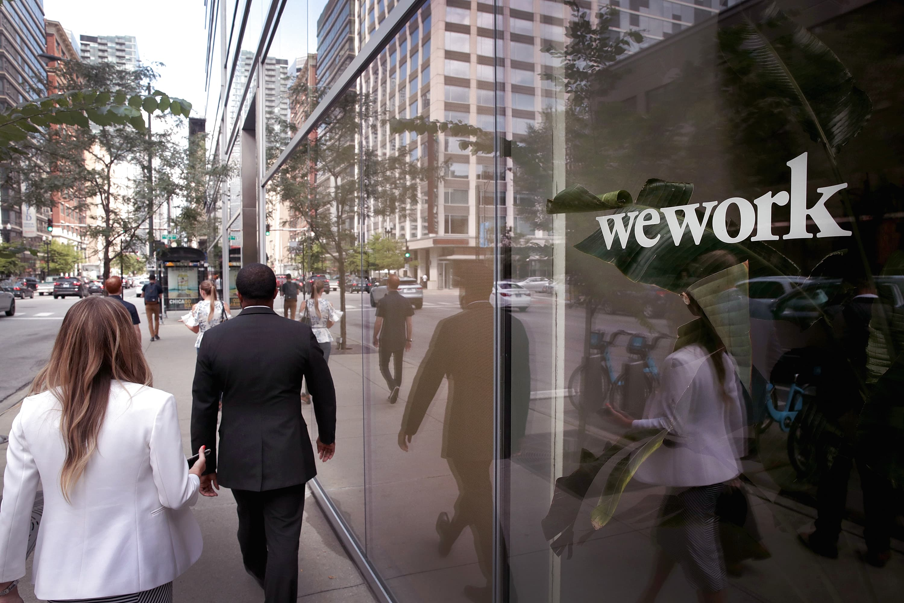 WeWork is dramatically slashing its IPO valuation because of weak demand