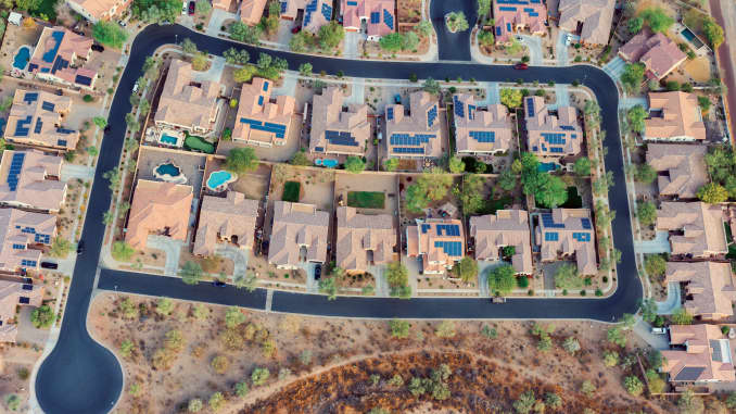 H/O home neighborhood with solar panels in southwest united states
