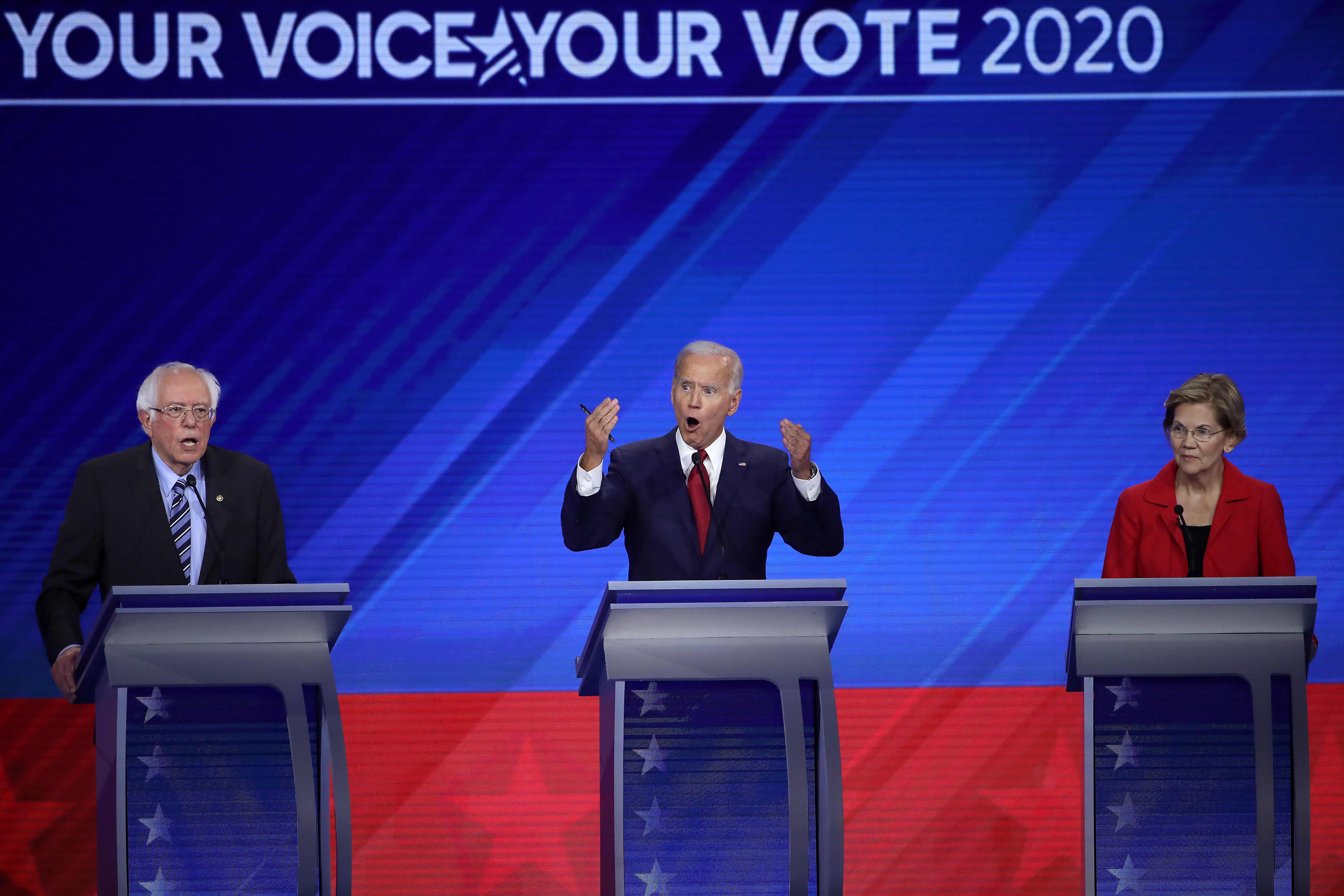 Biden goes after Warren and Sanders on health care in third Democratic primary debate