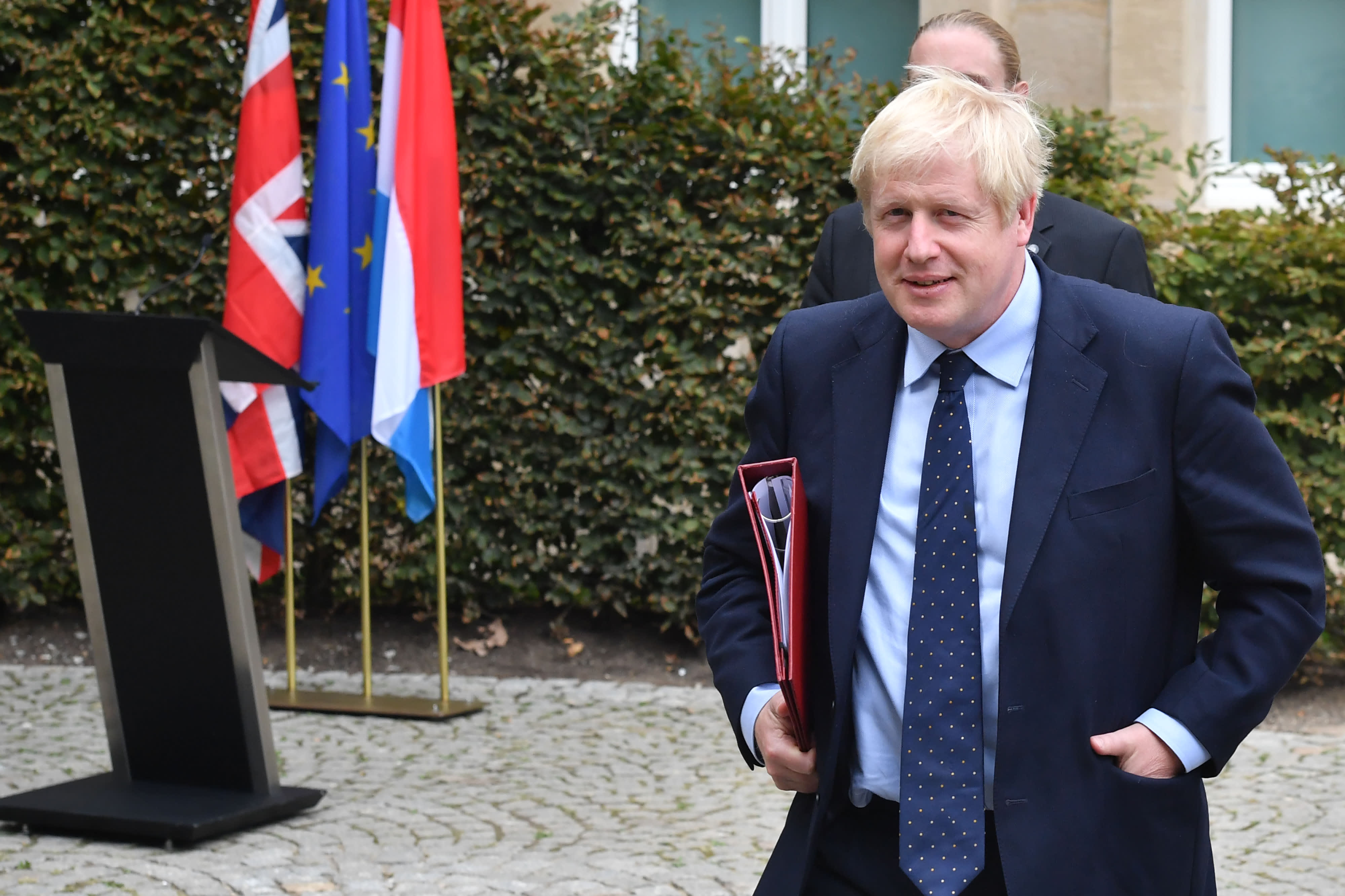 UK Prime Minister Johnson pulls out of press conference after crowd jeering