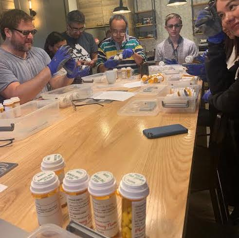 New hires at Amazon PillPack do 'empathy training' by sorting pills while wearing bulky gloves