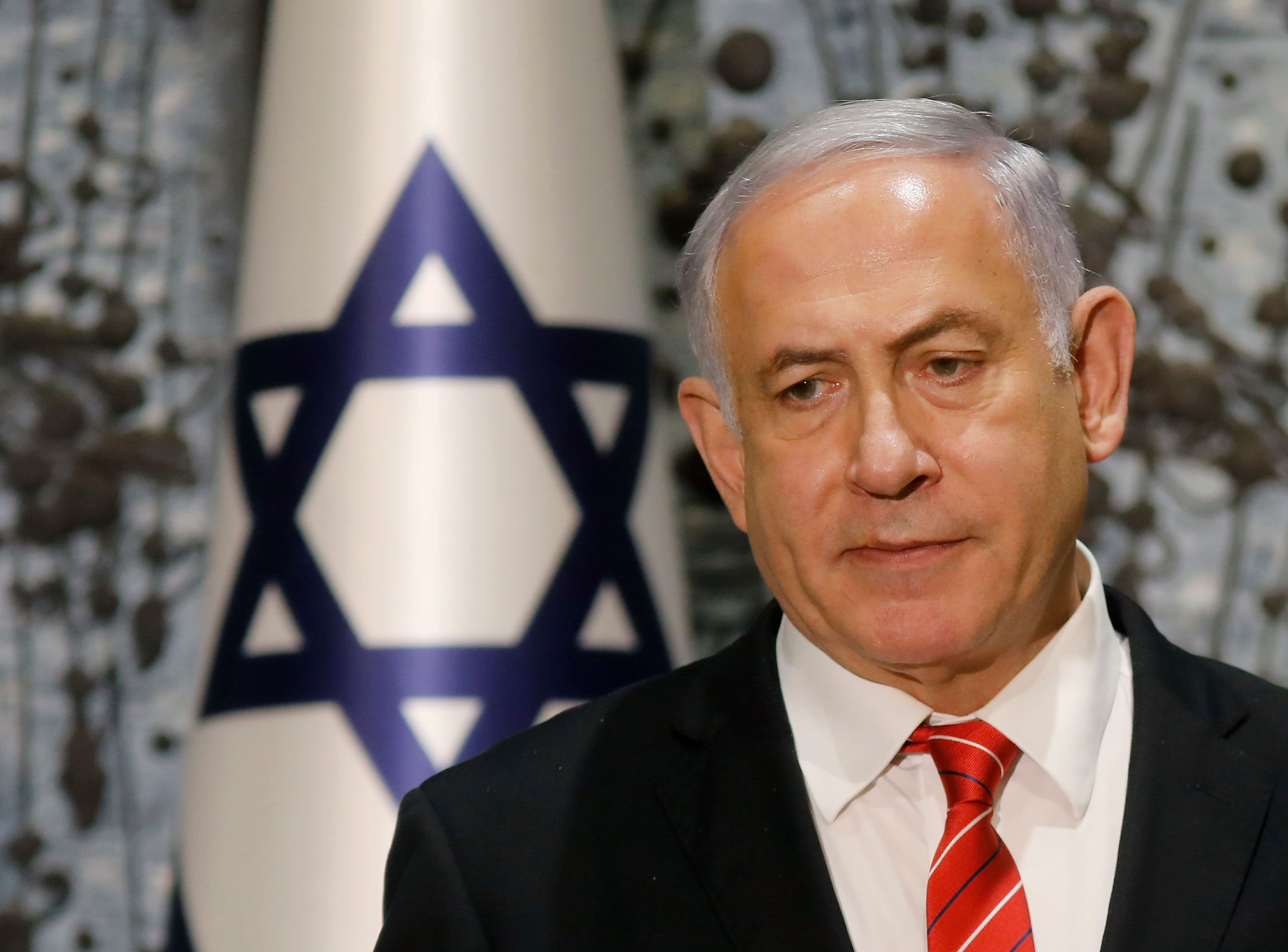 Israel's Netanyahu will seek parliamentary immunity from prosecution in corruption cases