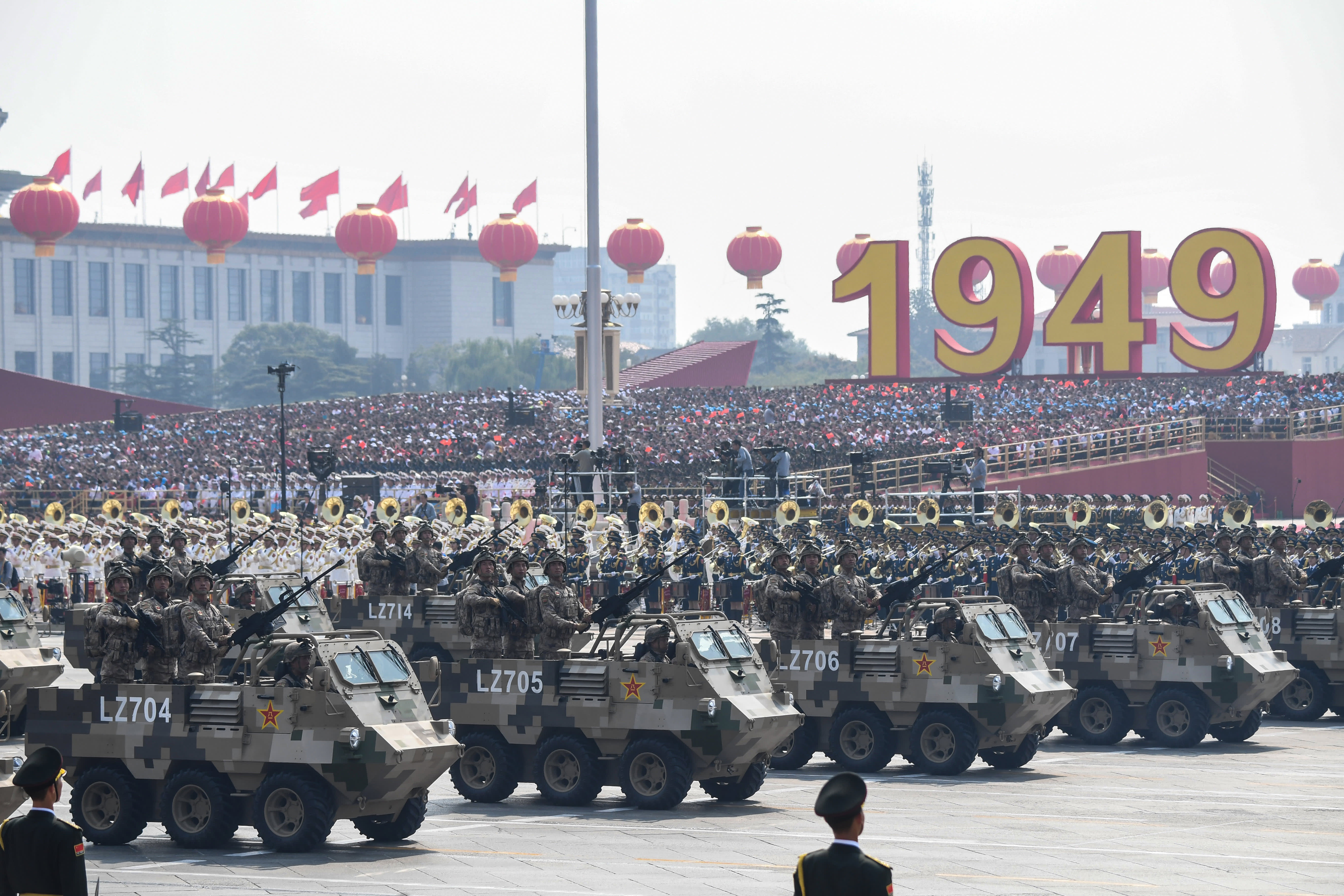 Amid economic challenges, China displays 'a military show of strength' at its 70th birthday bash