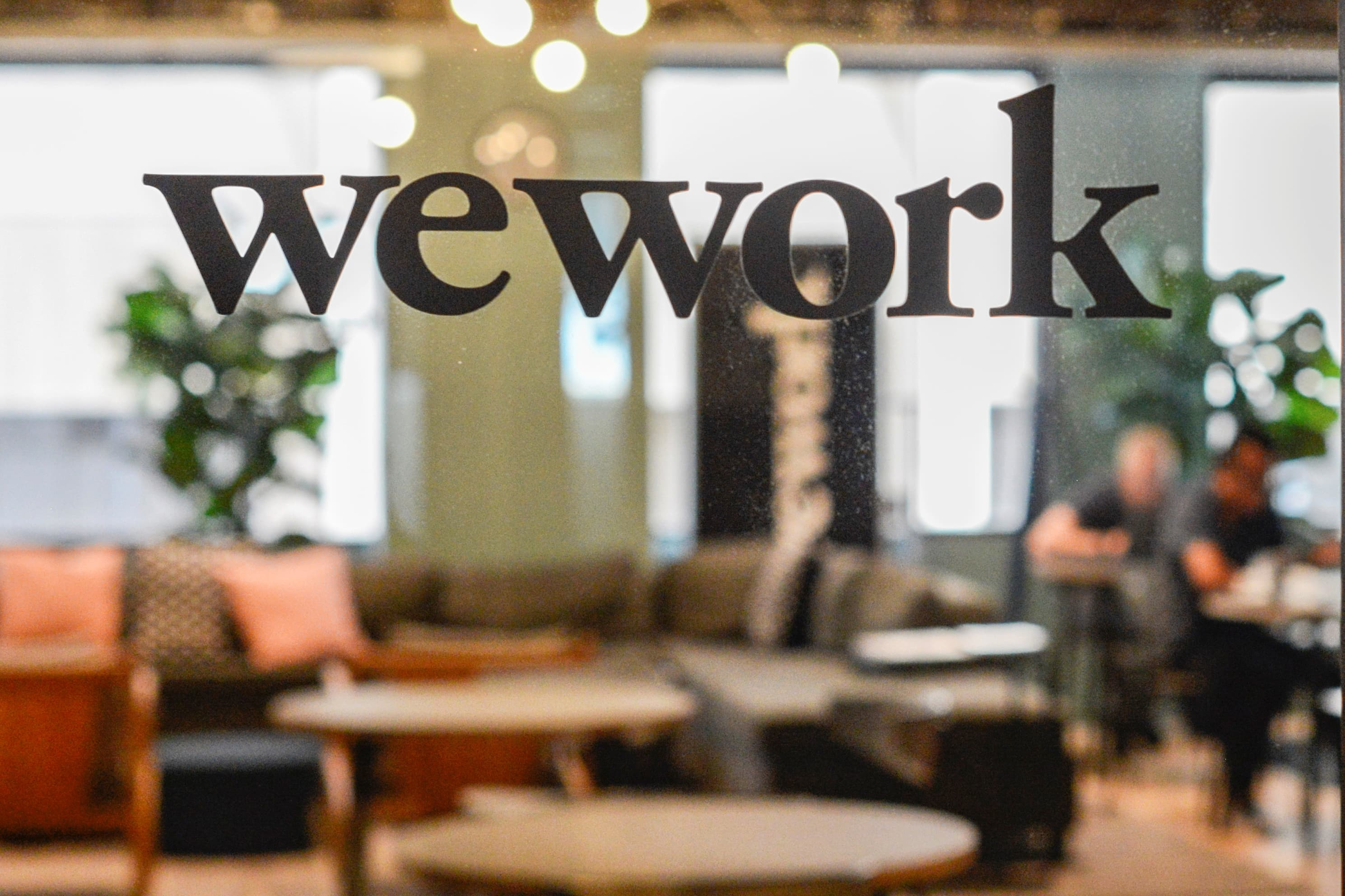 SoftBank will get the 'last laugh' when a 'profitable' WeWork goes public one day, Bernstein says