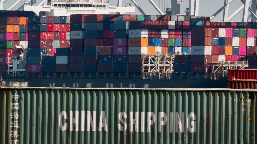 Shipping containers from China and other Asian countries are unloaded at the Port of Los Angeles as the trade war continues between China and the US, in Long Beach, California on September 14, 2019. -