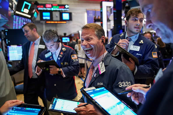 Dow closes at record high as Disney pops more than 7%