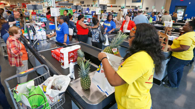 Shoppers check with their groceries during the grand opening of a Lidl grocery store, June 15, 2017, in Virginia Beach, Va.