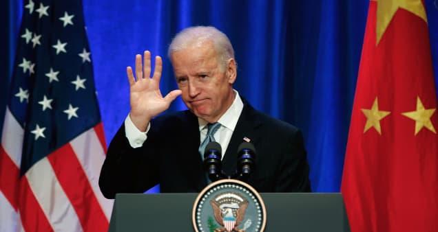 Biden says he won't immediately remove Trump's tariffs on China