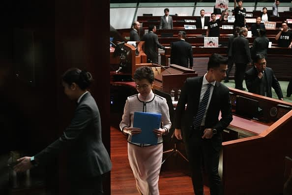 Carrie Lam shouted down by pro-democracy lawmakers on floor of Hong Kong parliament