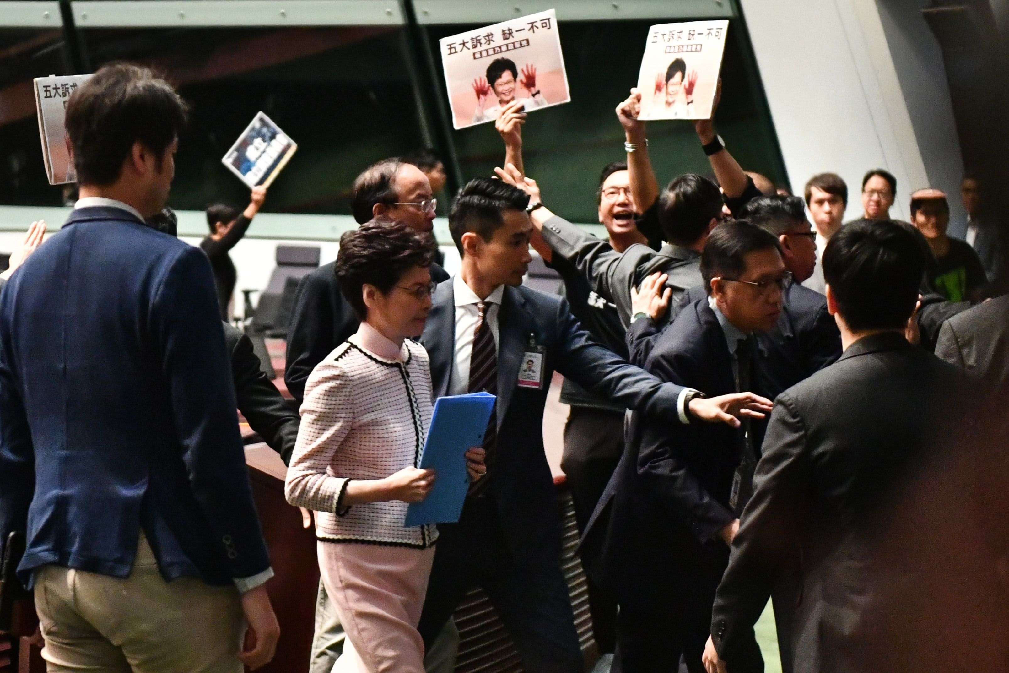 Pro-democracy lawmakers heckle Hong Kong leader, disrupting her annual policy speech