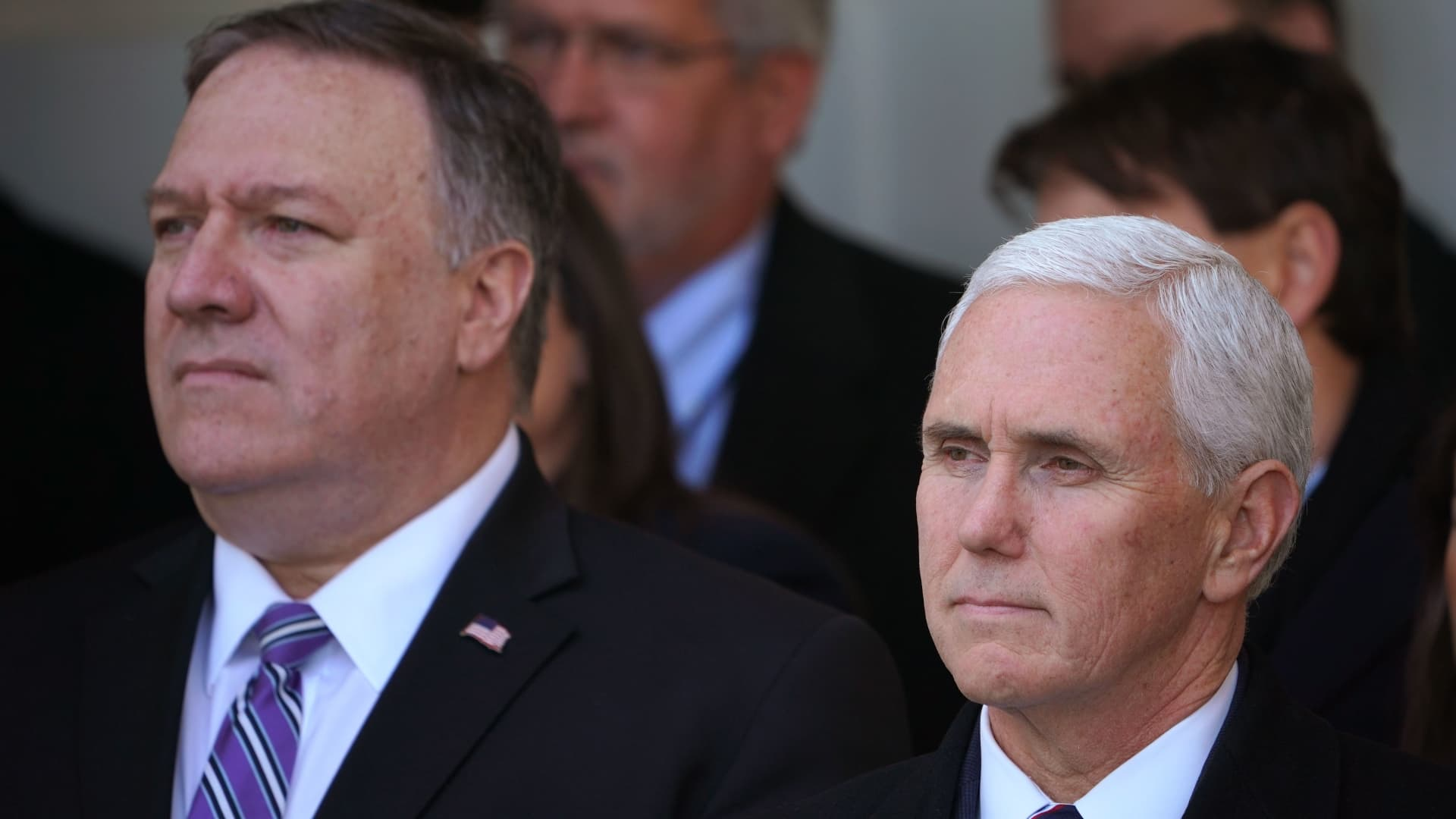 US Secretary of State Mike Pompeo (L) and Vice President Mike Pence listen as President Donald Trump speaks about the government shutdown on January 25, 2019, from the Rose Garden of the White House in Washington, DC. - Trump says will sign bill to reopen the government until February 15.
