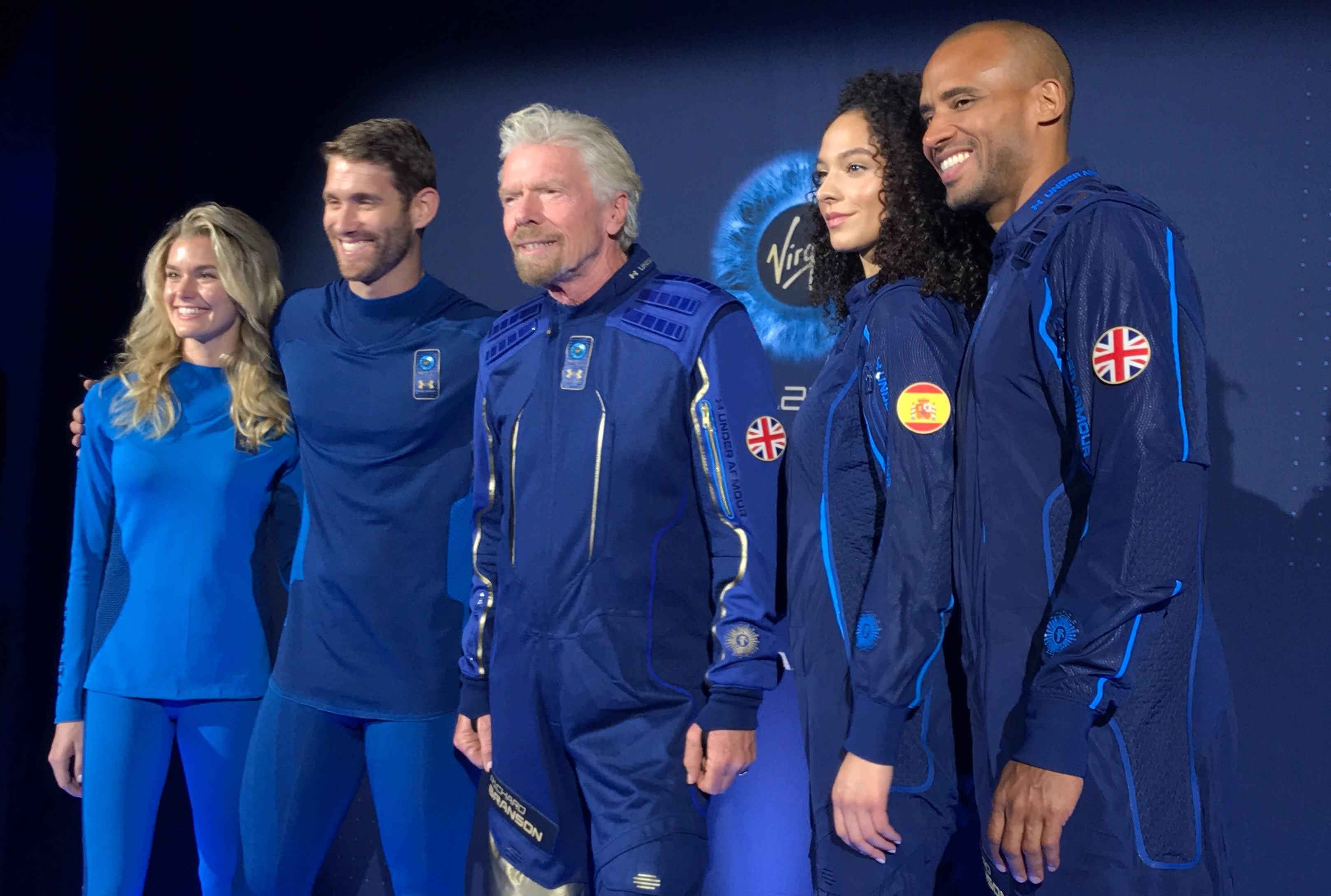 Virgin Galactic and Under Armour unveil spacesuits for the first space tourists to wear next year
