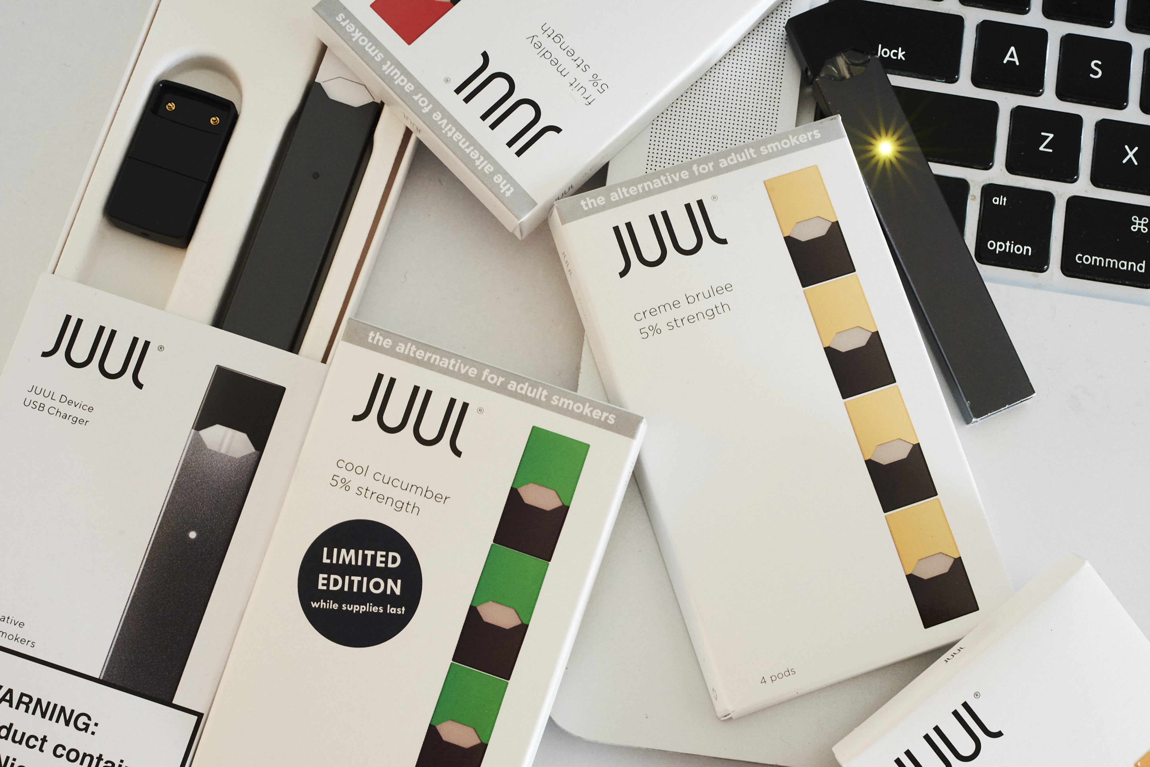 E-cigarette giant Juul suspends sales of all fruity flavors ahead of looming US ban