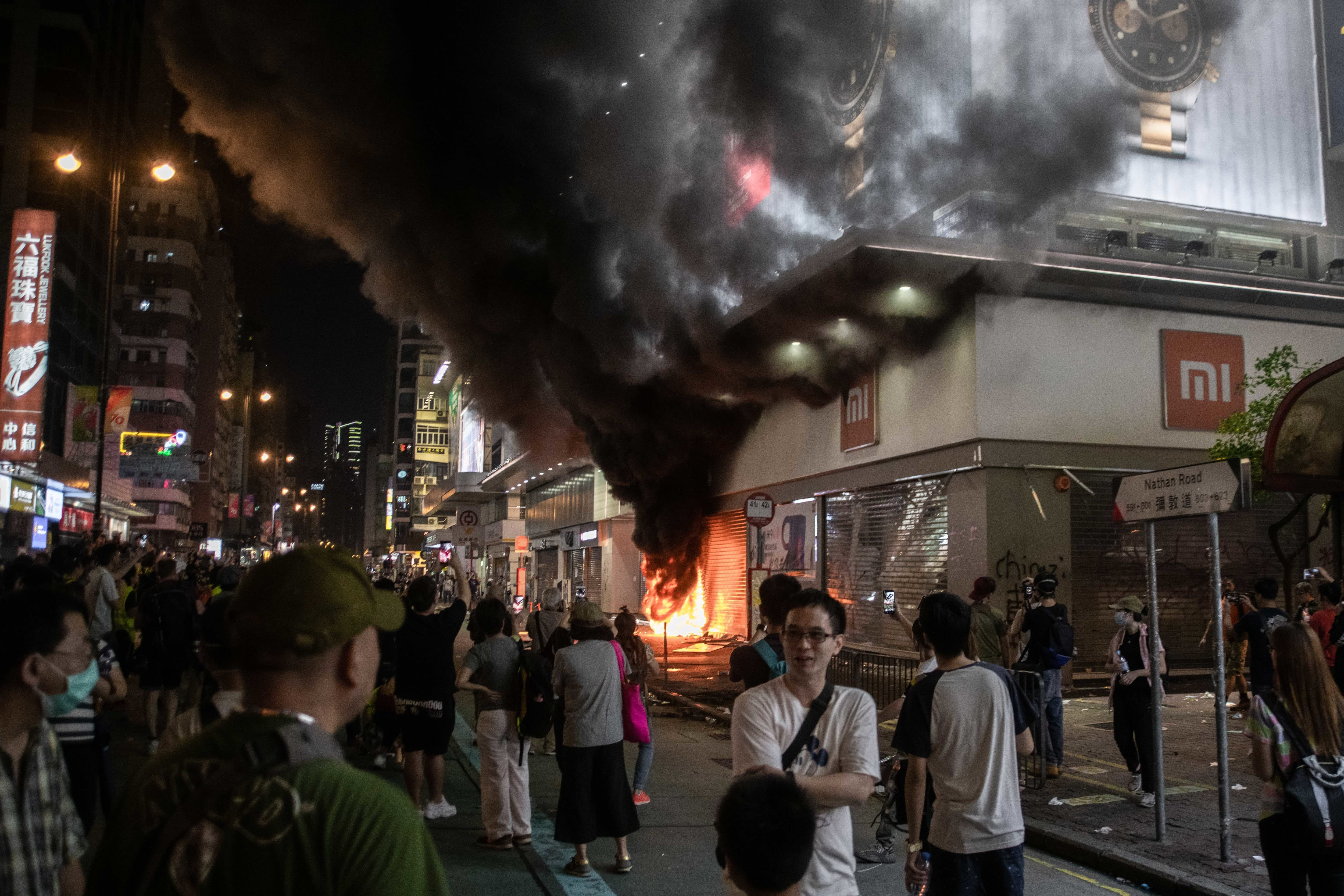 Hong Kong government pledges more aid, no end in sight to unrest