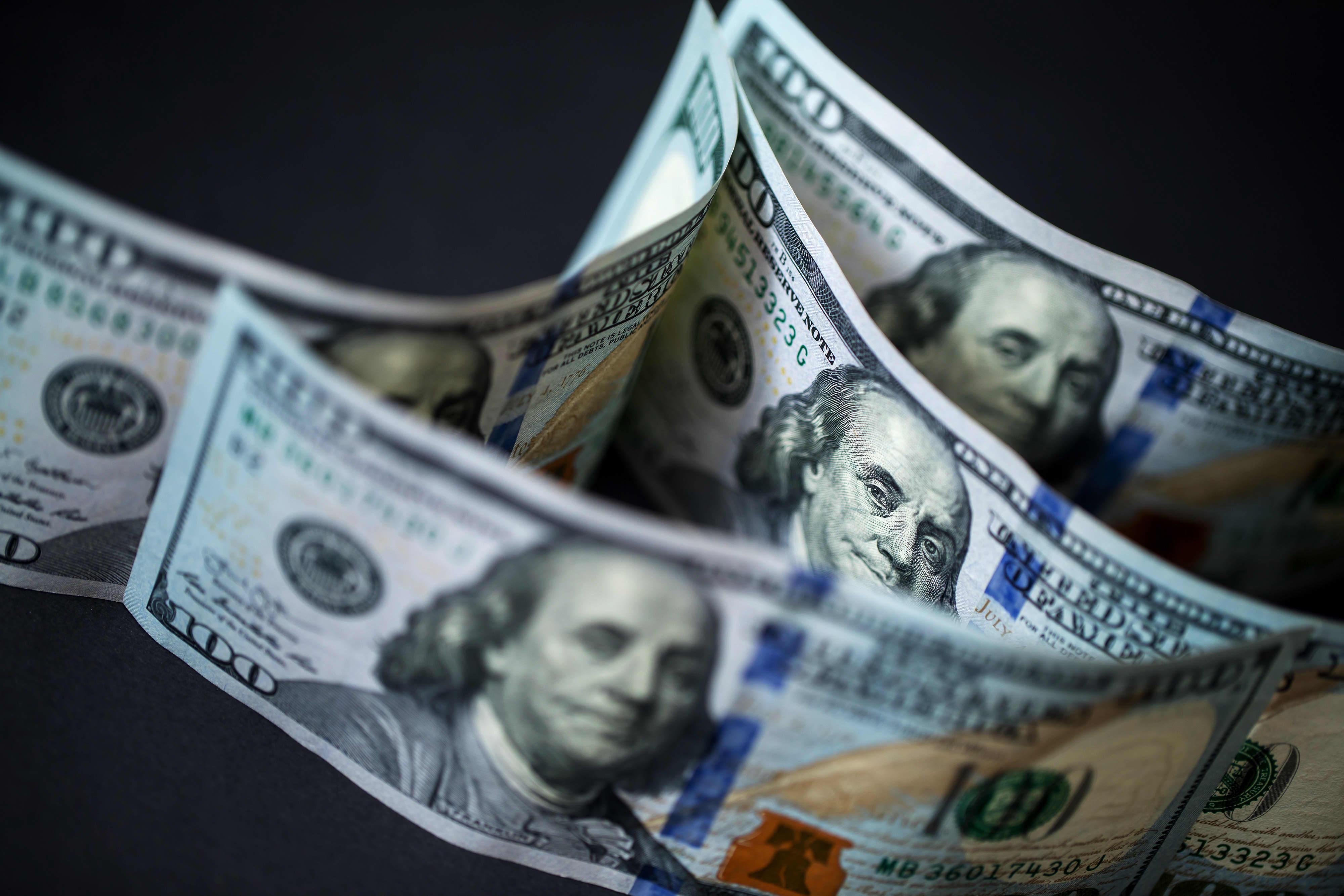 Dollar set for best week in a month as sterling nurses losses